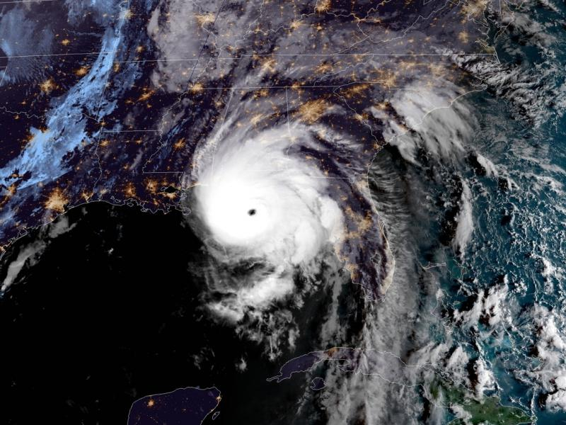 A satellite image from around 8 a.m. ET shows the well-defined eye of Hurricane Michael, as the storm's outer winds started to be felt on the Florida coast.