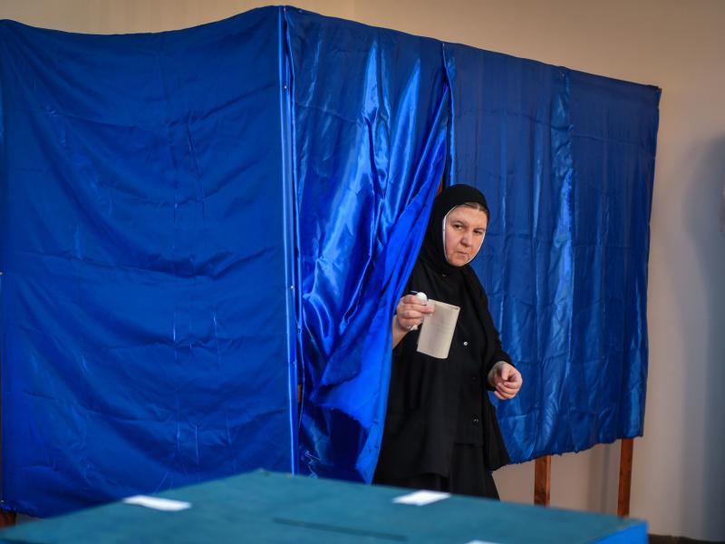 "A Romanian Christian-Orthodox nun votes at a polling station in the village of Branesti, Romania, in a referendum to change the constitutional definition of ""family"", on October 6, 2018."