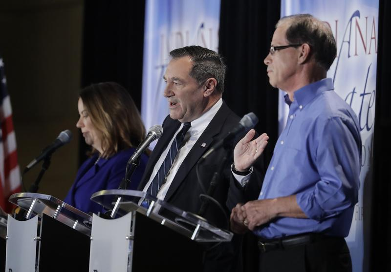 U.S. Sen. Joe Donnelly (D-Ind.), center, speaks during a U.S. Senate debate against Republican Mike Braun, right, and Libertarian Lucy Brenton, left. (Photo courtesy Indiana Debate Commission, Darron Cummings/AP)