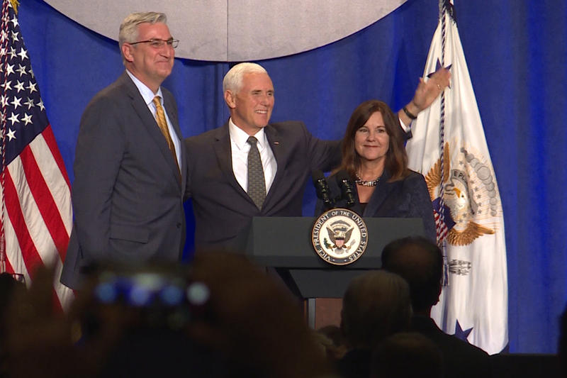 Indiana Gov. Eric Holcomb, Vice President Mike Pence and Second Lady Karen Pence share the stage at a fundraising event in Indianapolis Friday. Pence attended to support GOP U.S. Senate candidate Mike Braun. (Lauren Chapman/IPB News)