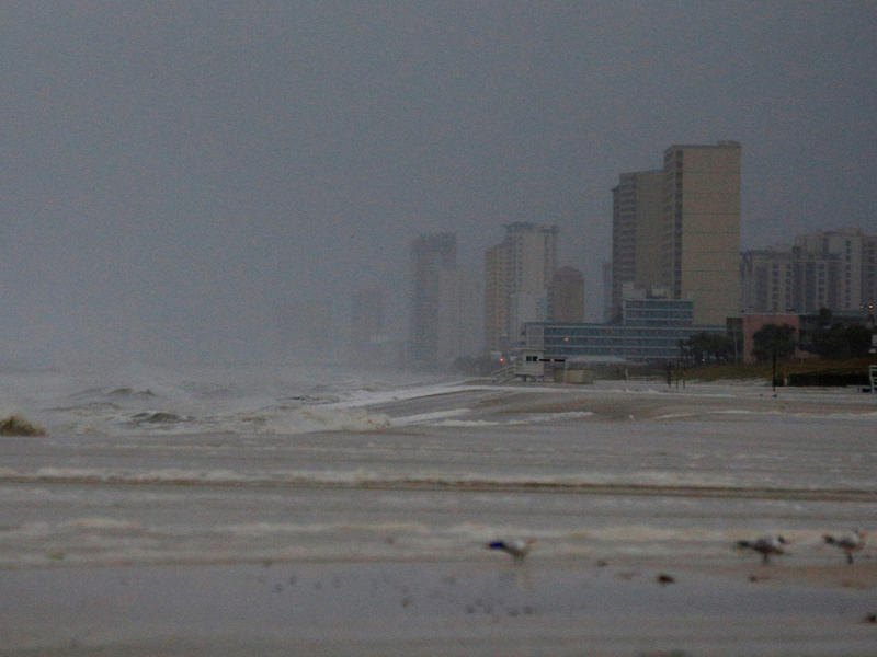 "Strong surf is seen at Panama City Beach on Wednesday morning. By the afternoon, ""a wind gust to 129 mph was reported at the Panama City Airport,"" the National Hurricane Center said."