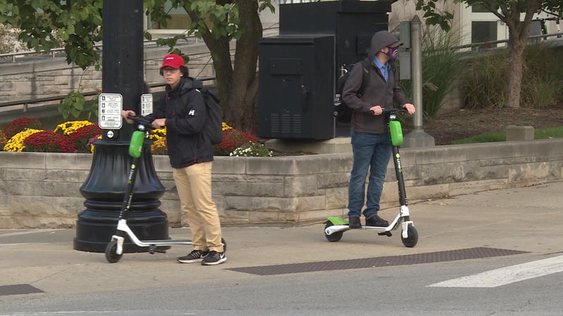 Students catch rides on Lime scooters at Indiana University (Zach Herndon/WTIU)
