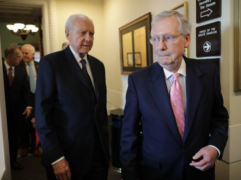 Senate Majority Leader Mitch McConnell, R-Ky., and Republican members of the Senate Judiciary Committee, including Sen. Orrin Hatch, R-Utah, arrive for a news conference on Thursday, reiterating their plan to bring Brett Kavanaugh's Supreme Court nominati