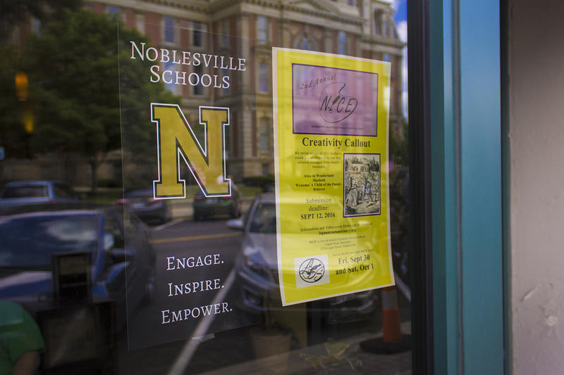 A poster for Noblesville Schools hangs in a coffee shop window. (FILE PHOTO: Peter Balonon-Rosen/IPB News)