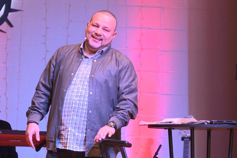 Pastor Don Ramirez preaching at his new space. (Tyler Lake/WTIU)