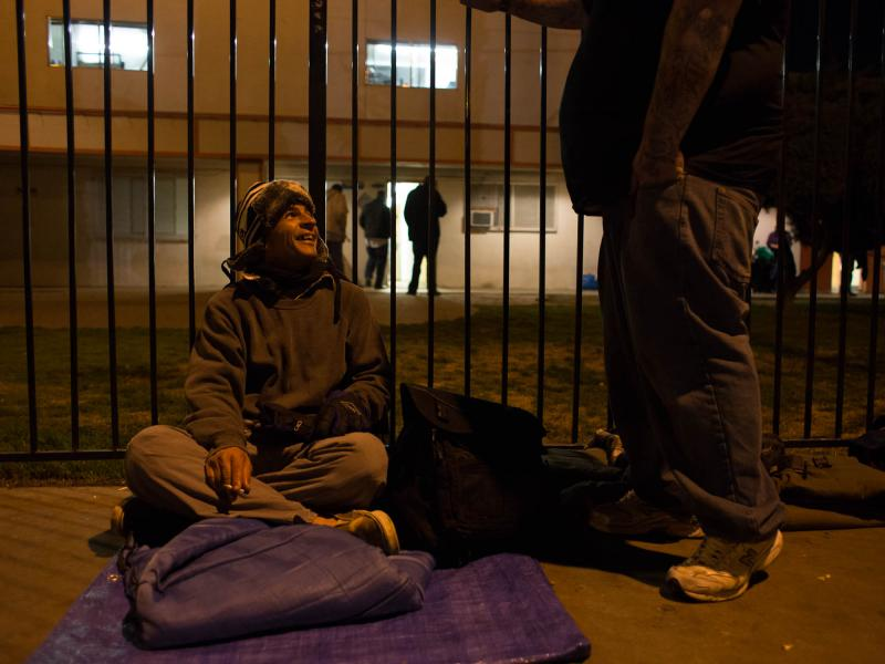 Everett May, 37, waits with a friend while others complete surveys for the homeless count. They each receive a $5 McDonald's gift card and plan to get dinner together.