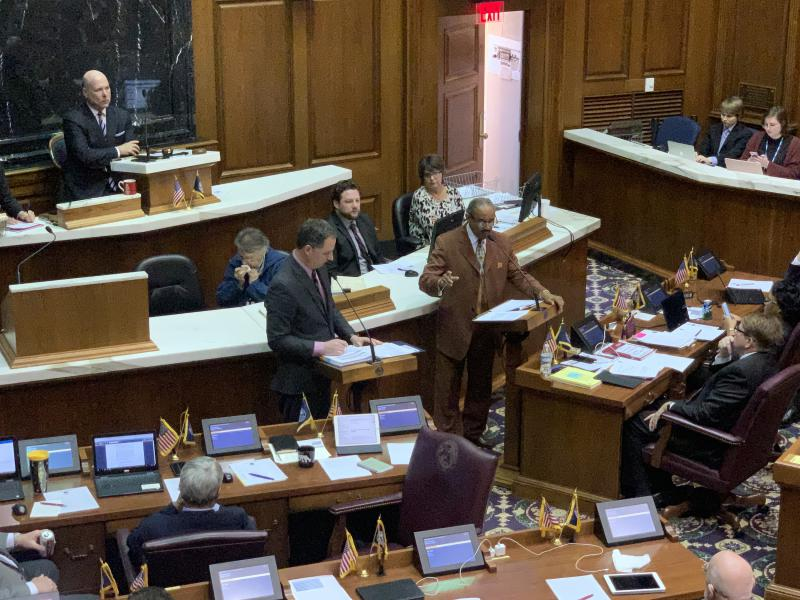 Rep. Todd Huston (R-Fishers) debates the budget bill with Rep. Vernon Smith (D-Gary). (Brandon Smith/IPB News)