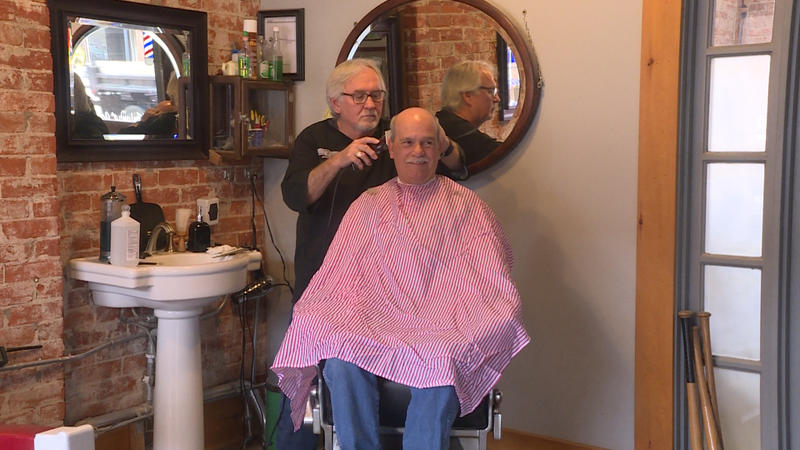 Barber Dan Fleener cuts Morgan County Commissioner Kenny Hale's hair at his shop in Martinsville (Rebecca Thiele/IPB News)