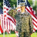 Female veteran saluting American flags. Veterans pbs rewire