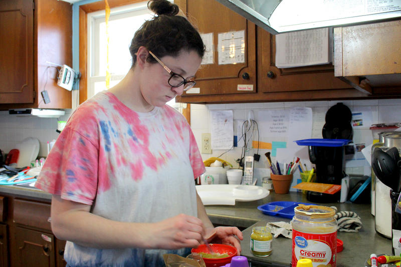 Trinaty Carr prepares oatmeal for the infant during snack time at her licensed in-home daycare. (Samantha Horton/IPB News)
