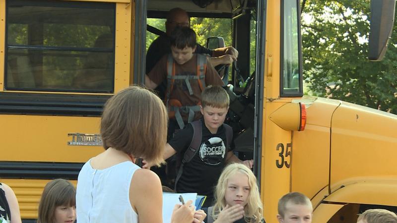 Kids getting off a school bus (WFIU/WTIU)