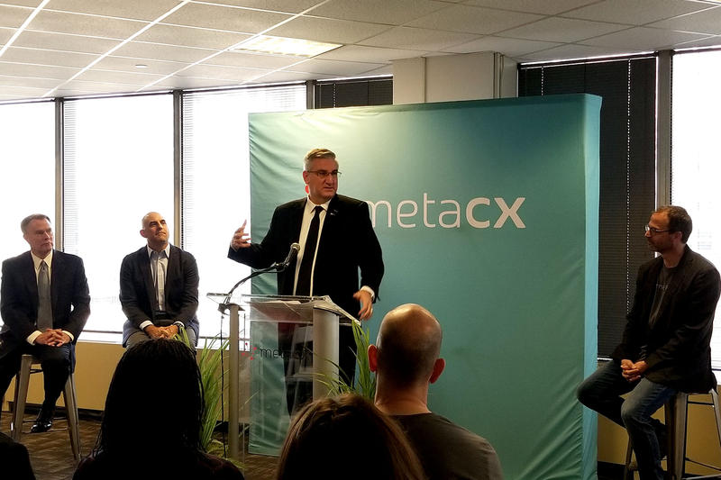 Gov. Eric Holcomb joined by city and MetaCX leaders gives remarks on the tech companies growth. (Samantha Horton/IPB News)