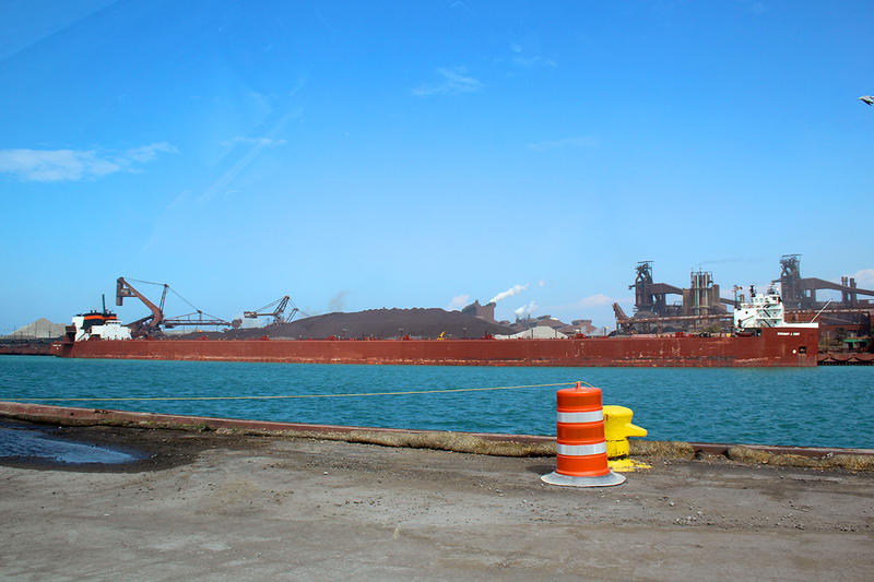 """A semi-automated """"laker"""" ship, the Stewart Cort, offloads iron ore at the steel-maker ArcelorMittal across from the Port of Indiana-Burns Harbor. (FILE PHOTO: Annie Ropeik/IPB News)"""