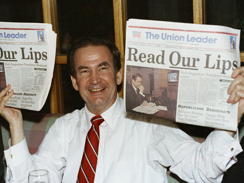 After claiming over one-third of the vote in the 1992 New Hampshire GOP primary, candidate Pat Buchanan holds up copies of a local newspaper with a headline evoking a broken campaign promise of incumbent Republican President George H.W. Bush.