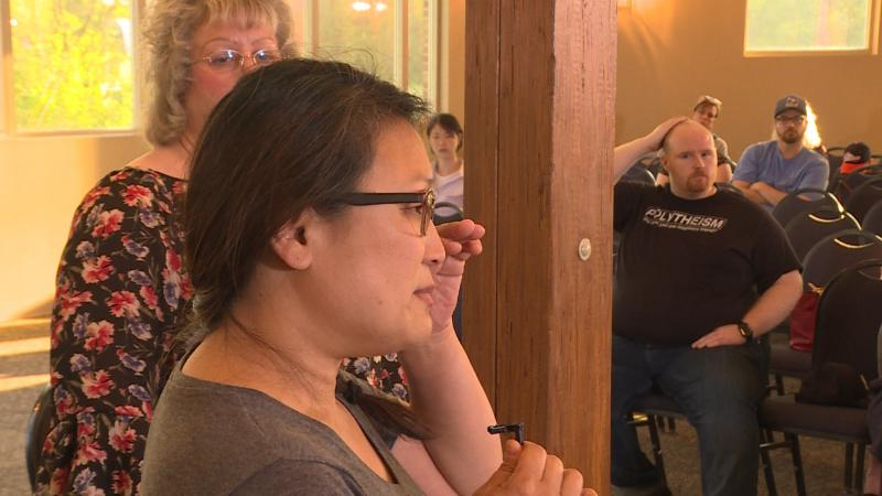 It was an emotional night for many people in Franklin, like Michelle Dahl, who no longer feels safe sending her two youngest kids to elementary school in Franklin. (Rebecca Thiele/IPB News)