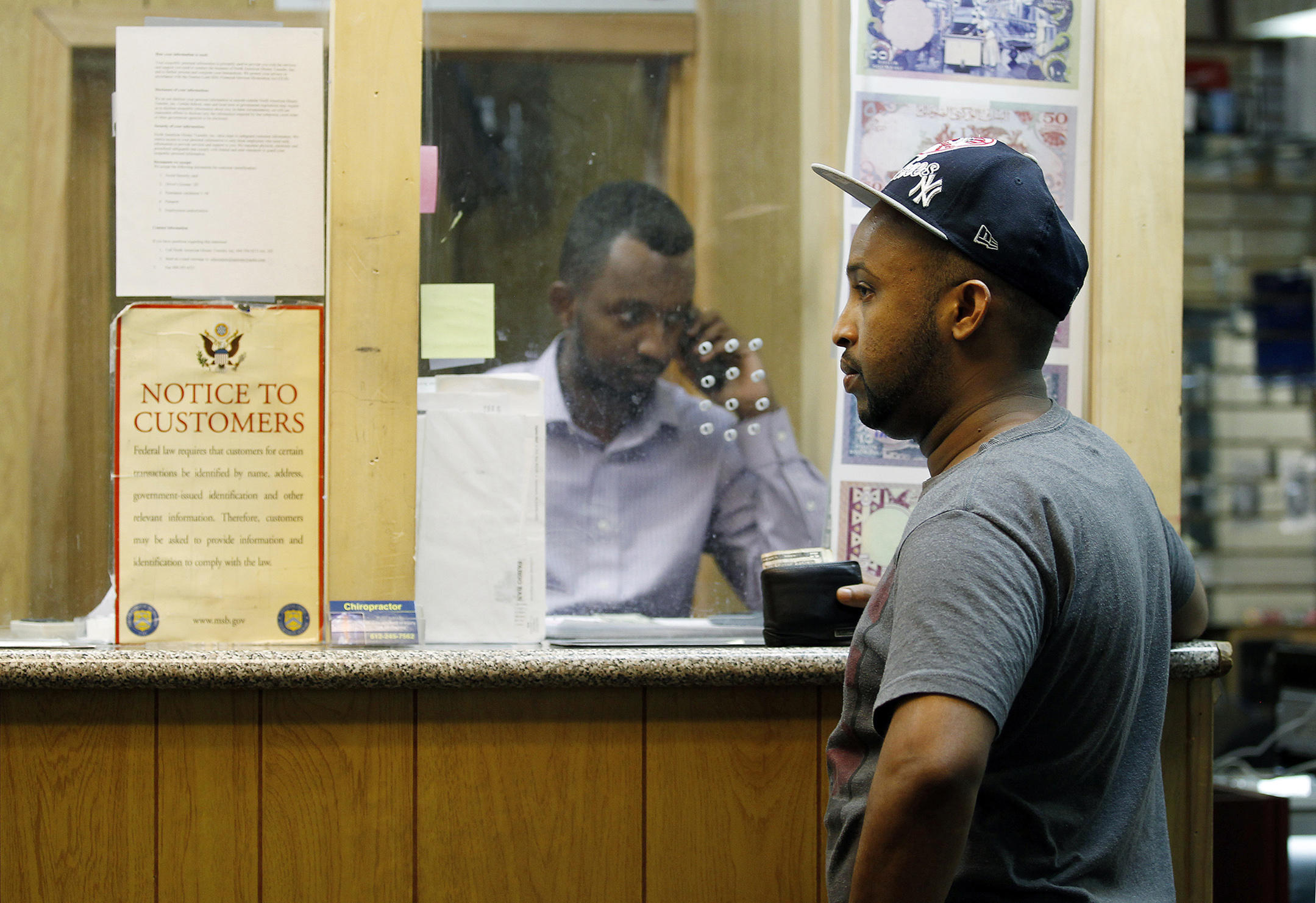 Mohammed Ahamed Waits At A Money Transfer Business In Minneapolis To Send His Ex Wife Somalia About 40 Percent Of All Somali Families Rely On
