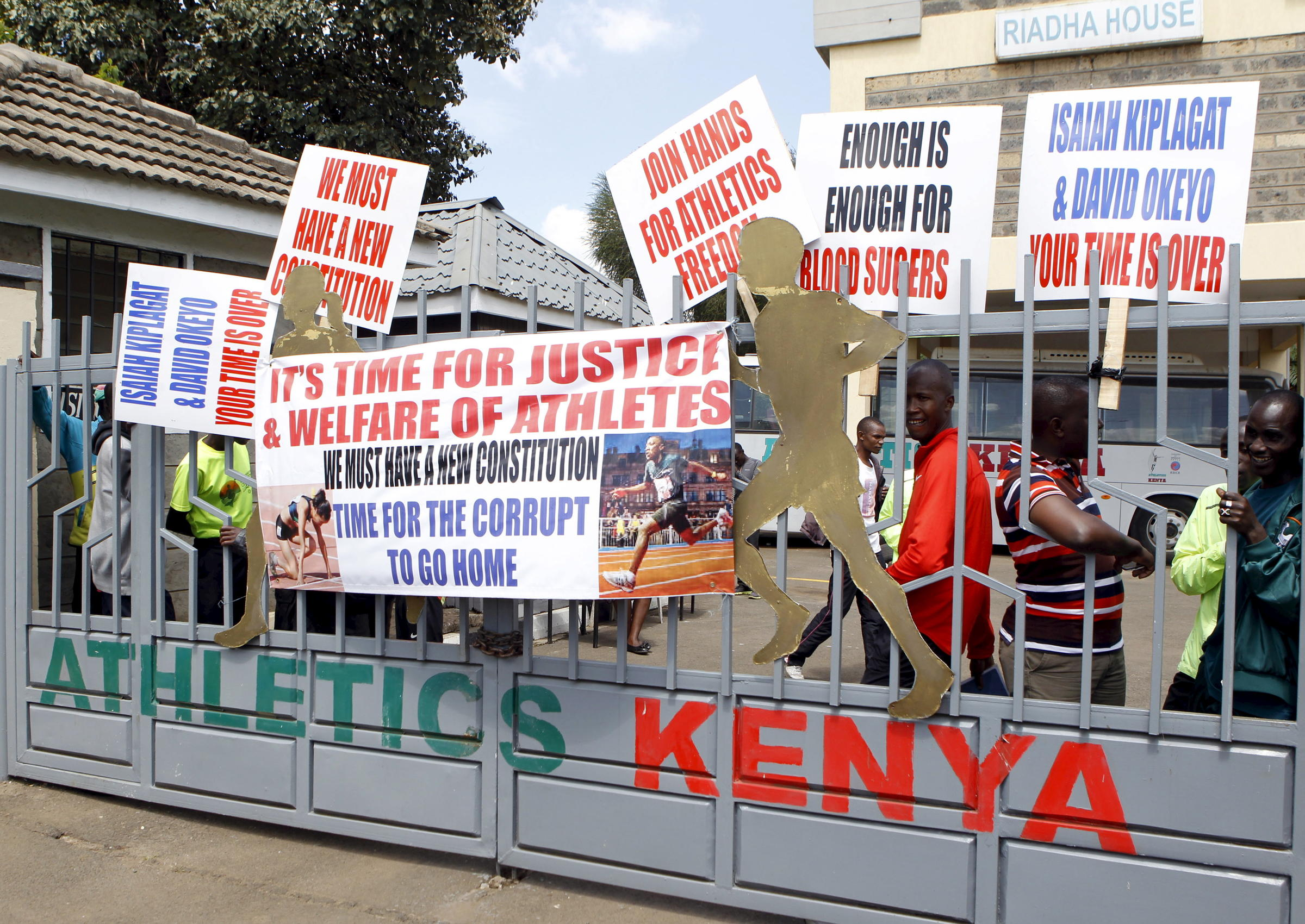 5bd530ad978b Protesting Kenyan athletes place placards behind closed gates at Riadha  House the Athletic Kenya (AK) Headquarters in capital Nairobi November 23