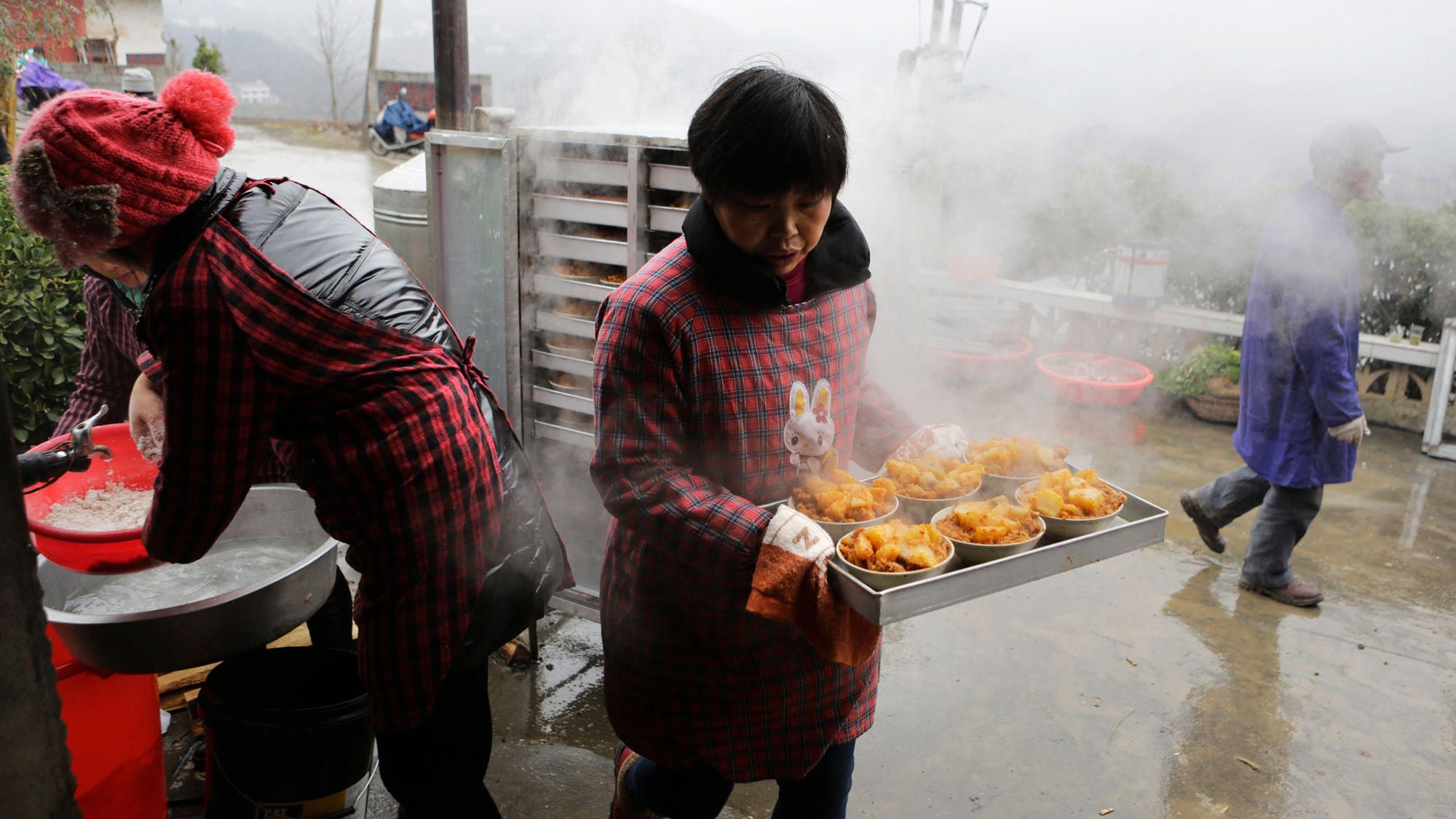 Cooking chinese food is all about family and friends wlrn a local cook prepares a traditional ethnic tujia wedding feast during celebrations marking the lunar new year in chinas hubei province forumfinder Choice Image