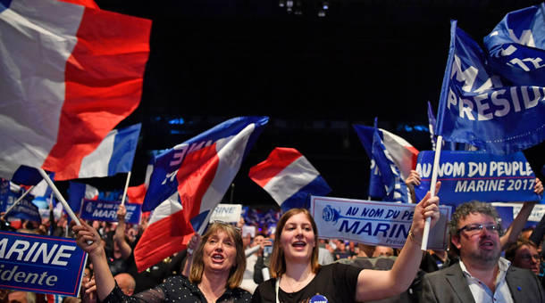 Far-right supporters attend a presidential campaign rally by National Front leader Marine Le Pen at the Dome De Marseille on Wednesday.   Sam Beard