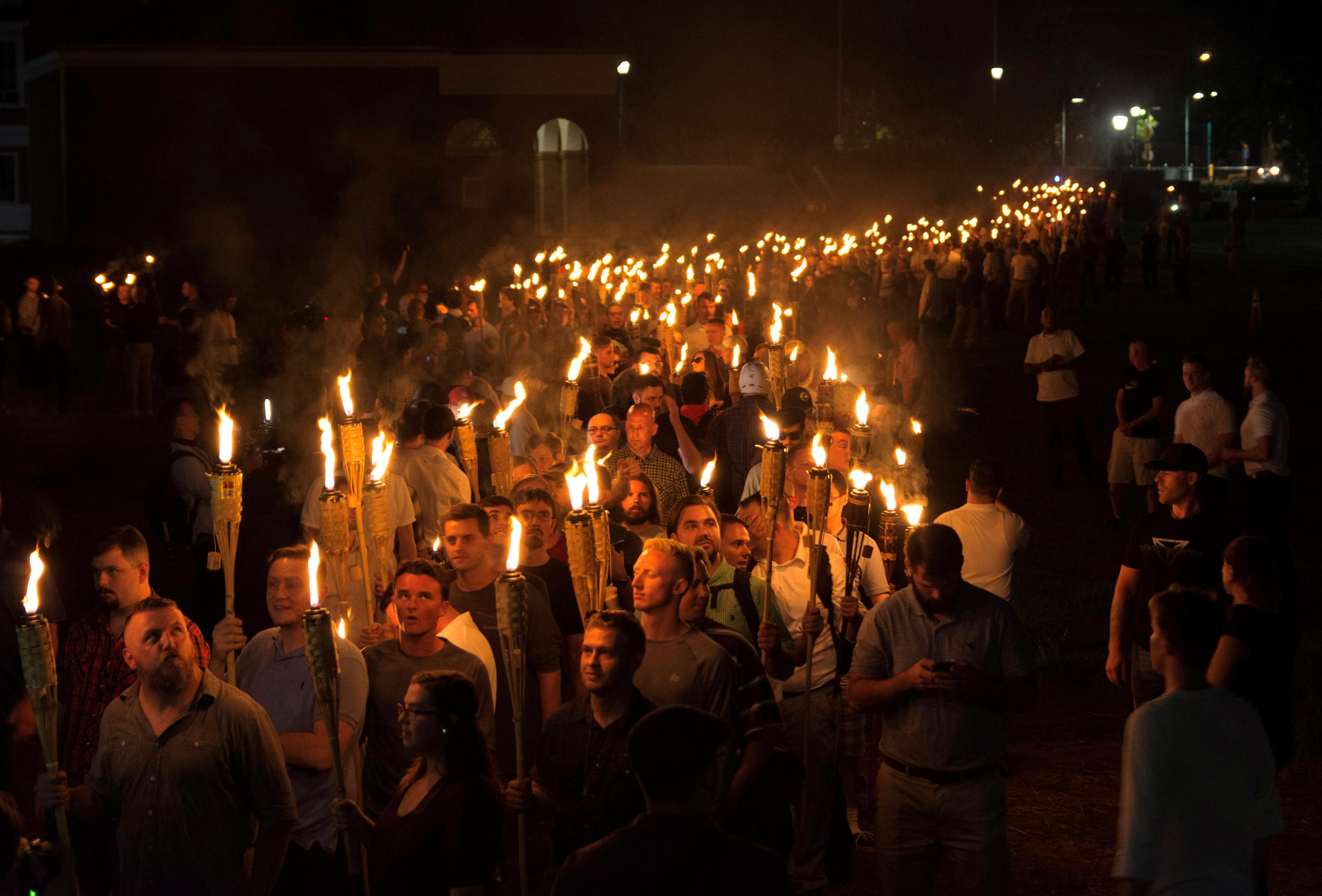 Virginia football players participate in candlelight vigil in Charlottesville