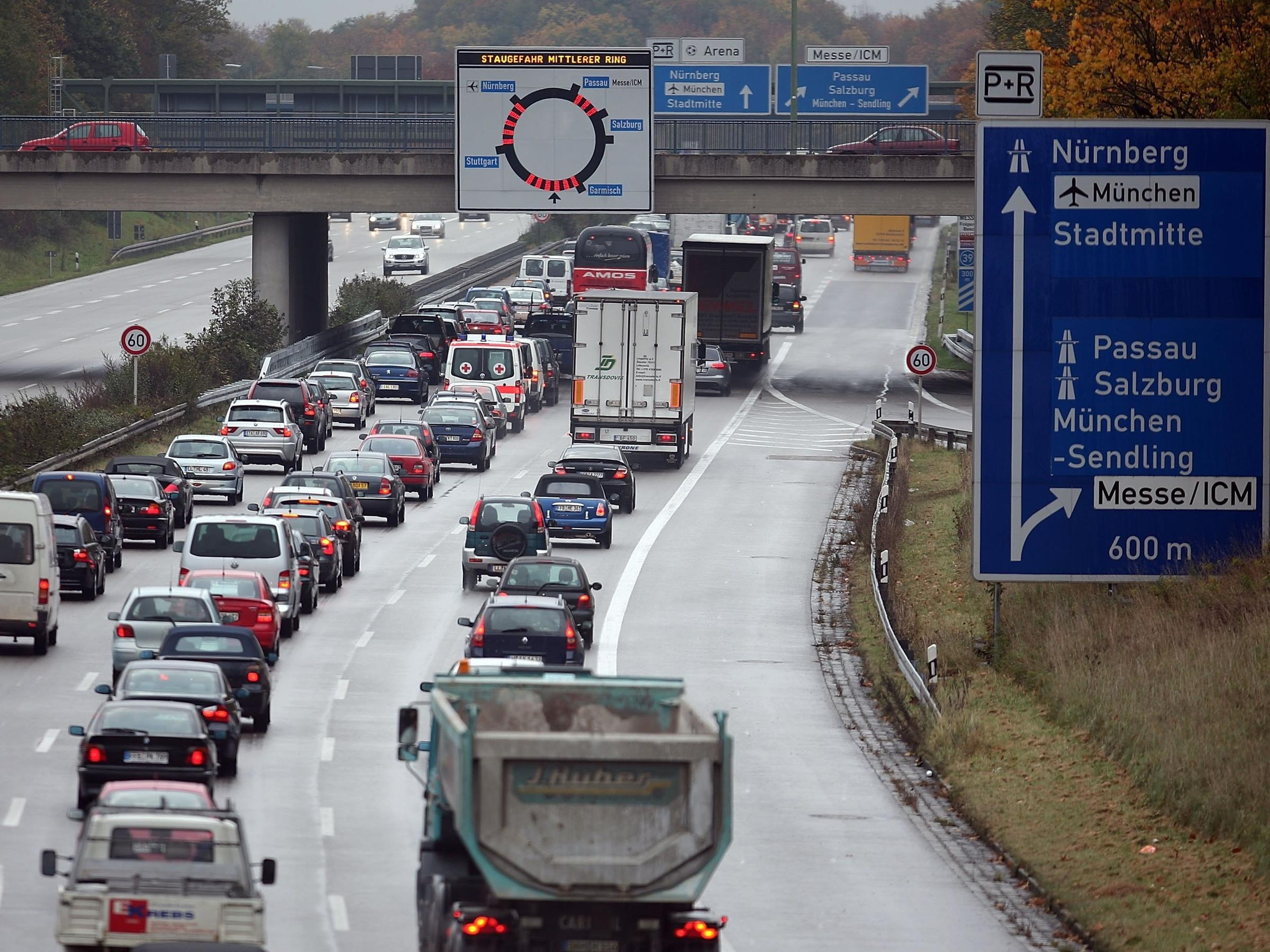 To meet EU air pollution targets Germany may make public transit free in cities struggling with poor air quality. Here a Munich traffic jam in 2007