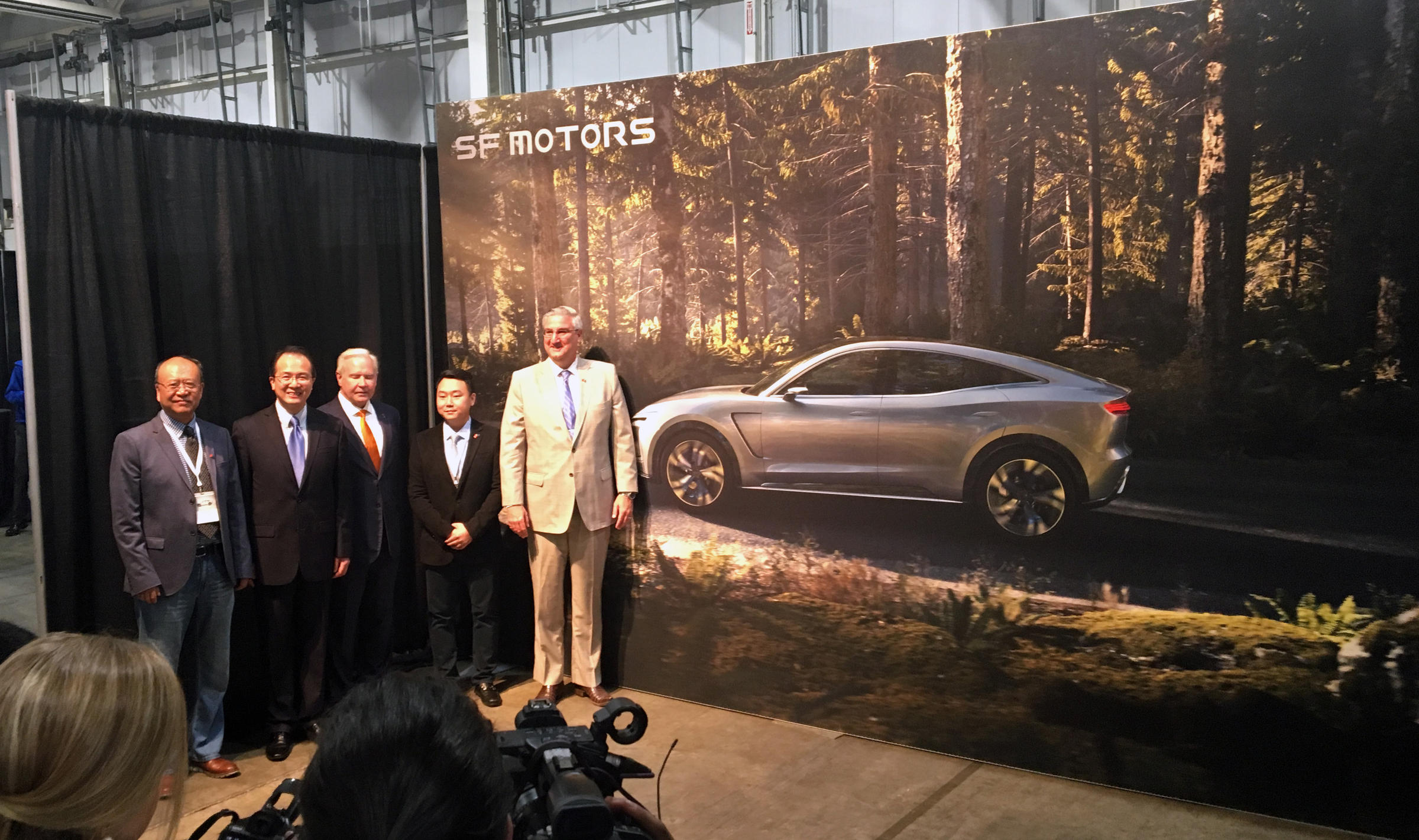 Governor Eric Holcomb poses with Indiana Secretary of Commerce Jim Schellinger, SF Motors CEO John Zhang and other SF officials in the Mishawaka EVAP.