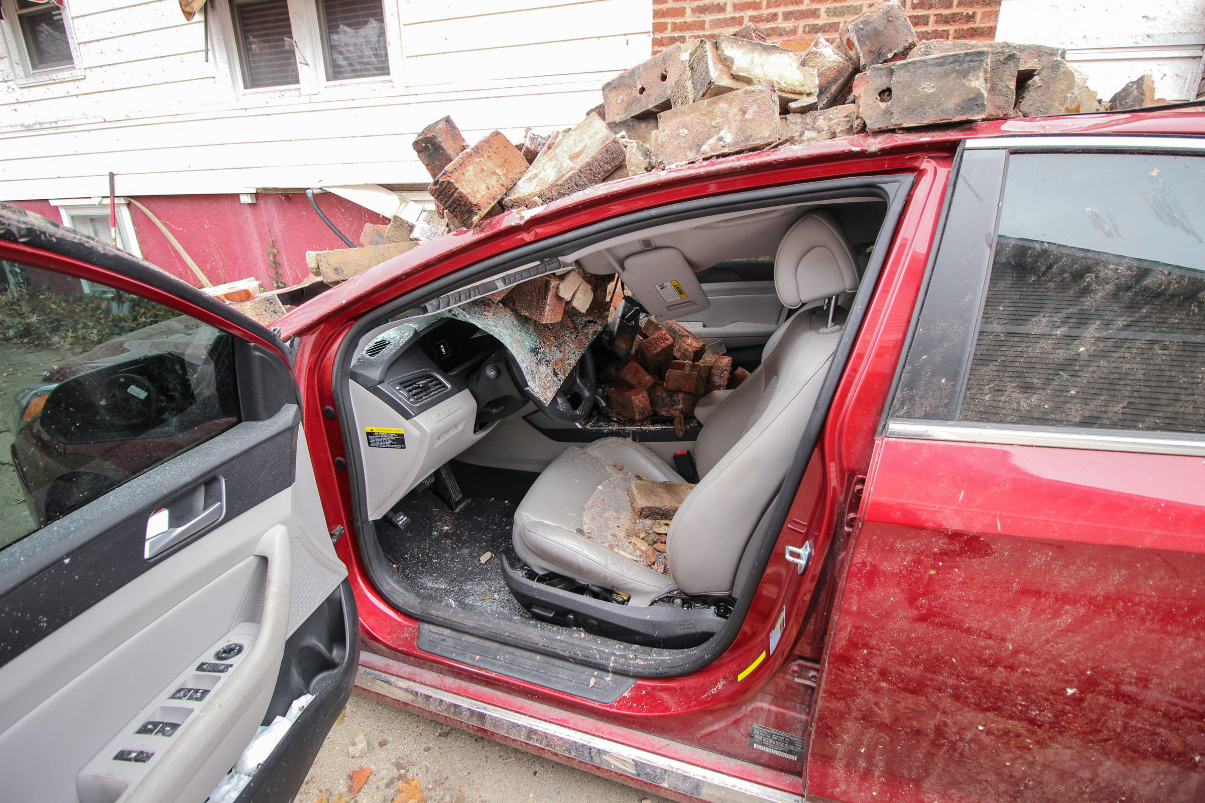 A brick chimney smashed through the roof a car during Saturday's tornado in Taylorville Illinois