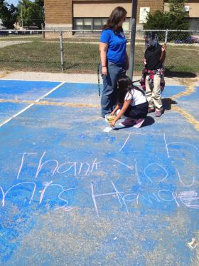 """At the end of the first week of class, two students - Ameera and Ashley - write a note for Renee Howard in chalk. The note says, """"Thank you Mrs. Howard."""" """"Thank you for what?"""" she asks. """"Thank you for being our teacher."""""""