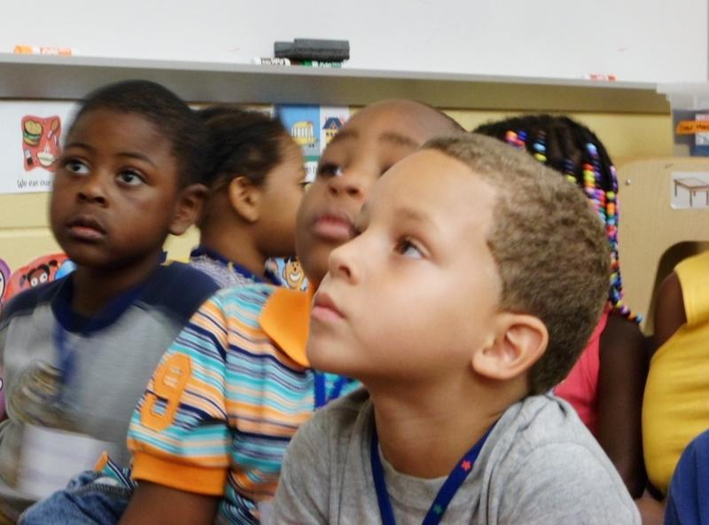 David Blair and his classmates listen to story time during a Grand Rapids Public Schools summer preschool class.