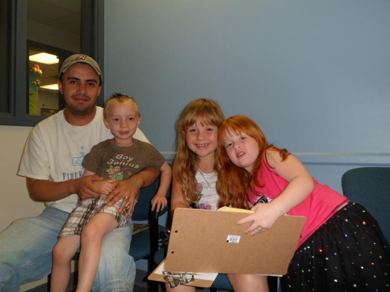 The Romo family. Hunter, his dad and two cousins at the Washtenaw County Health Plan.