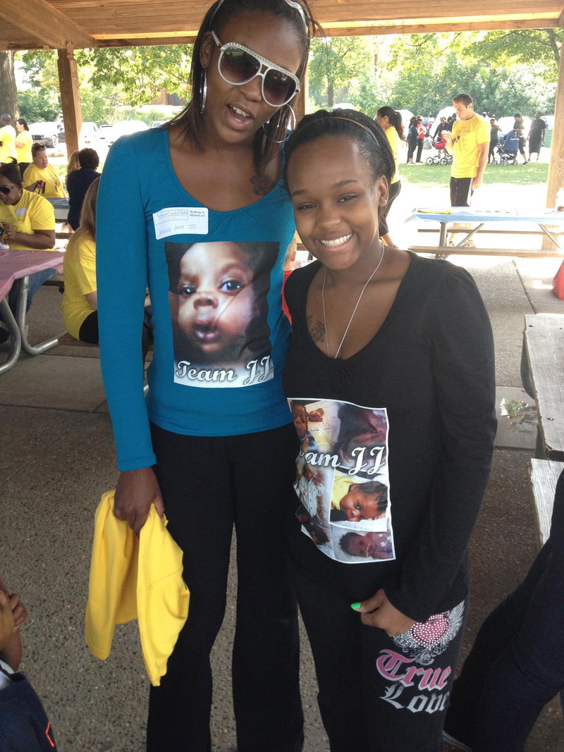 "Chantania Smith (right) and a friend wear ""Team JJ"" outfits at a benefit walk to raise money for SIDS and other infant death research."