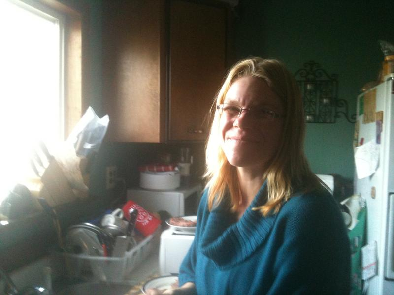Amber Pedersen in her home. She was able to move herself above the poverty line with the help of some government programs.