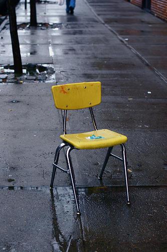 yellow chair in the rain