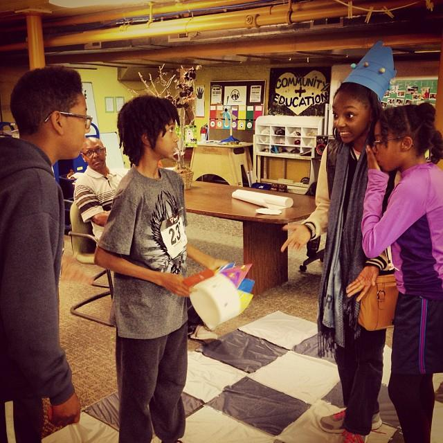 Young makers play a game of life-size chess at Detroit's Mt. Elliott Makerspace.