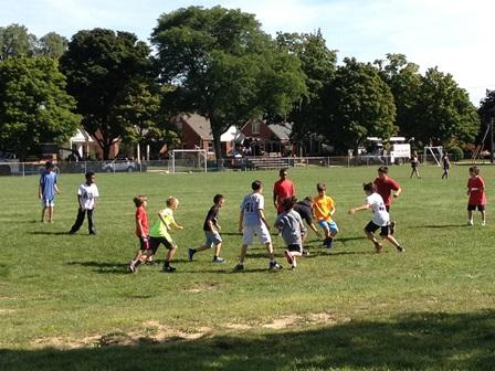 Some students play a quick game of football during recess