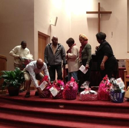 Each family receives a gift basket filled with household goods and non-perishable food items.