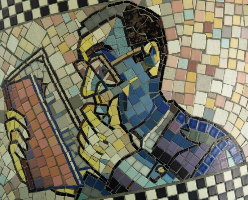mosaic mural of man reading