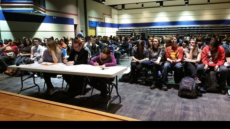 Students gather for a poetry slam organized by The Diatribe