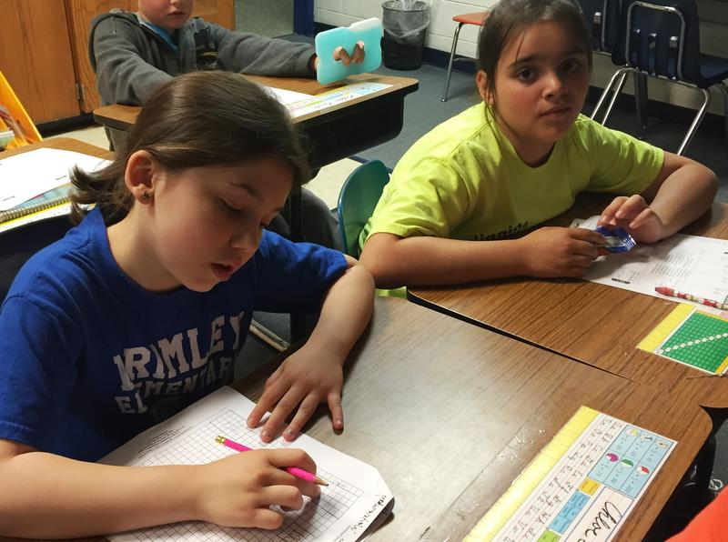 "Chloe Teeple (left) and Grace Hill are in 4th grade. They say their teachers are teaching them ""really really well."""