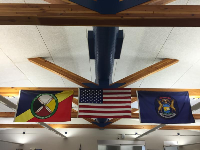 Brimley's cafeteria displays the Bay Mills Indian flag along with the U.S. and Michigan flags. Nearly 60% of students at Brimley are American Indian.