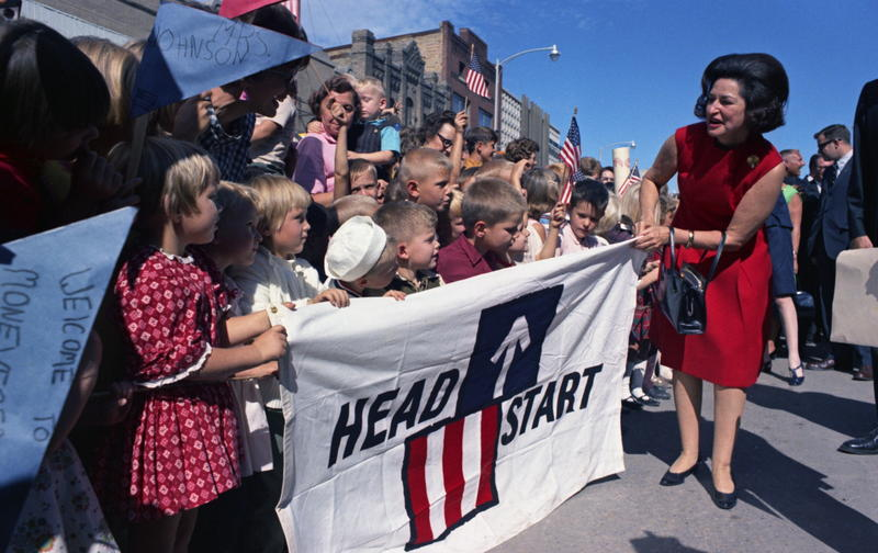 Lady Bird Johnson leads a group of children on the Crossroads USA tour in 1967.