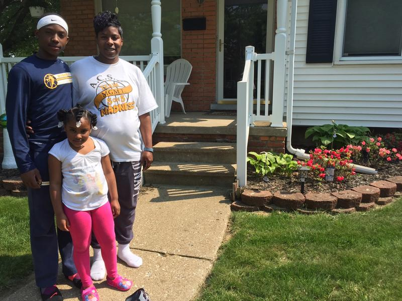 Jalin, Valencia and Irmitha Pitchford in front of their new home in Wyandotte.