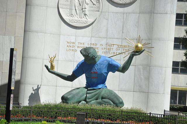 spirit of detroit statue wearing a detroit public schools t-shirt