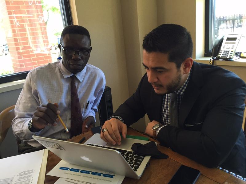 Abdul El-Sayed (right) meets with Joseph Mutebi