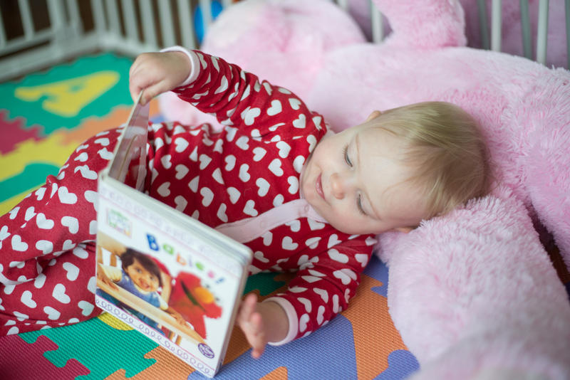 baby laying down reading