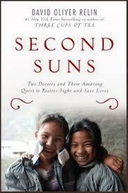 "Book cover: ""Second Suns: Two Doctors and their Amazing Quest to Restore Sight and Save Lives"" by David Oliver Relin"
