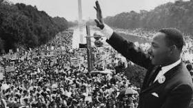Dr. Martin Luther King, Jr. waving to the crowd at the March on Washington in August 1963