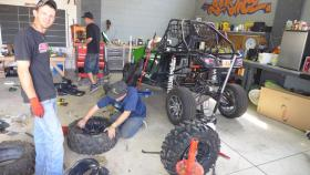 Workers maintain all-terrain vehicles at a shop in Moab.