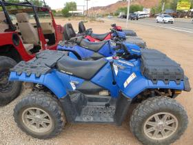 ATVs are lined up outside a Moab shop.