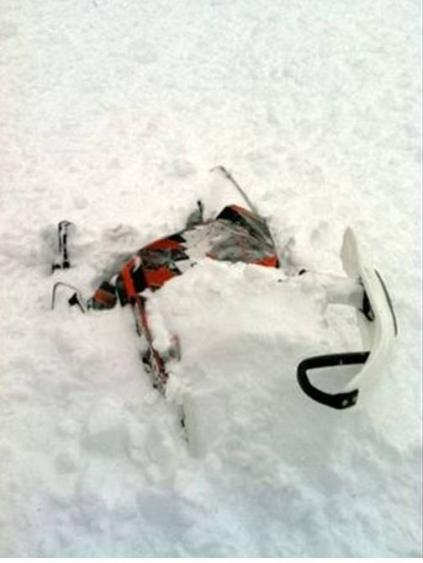 Utah Avalanche Center photo. A rider and his snowmobile were covered in an avalanche Feb. 22nd near Tony Grove in Logan Canyon. The rider's companions were able to rescue the man.